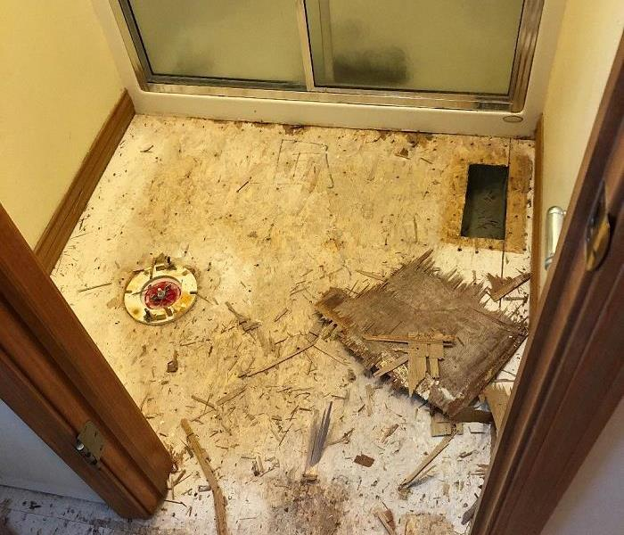 Damaged Bathroom Floor After Flooding